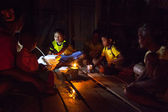 Unidentified people Orang Asli during a ceremonial dinner in his village — Stock Photo