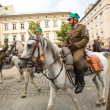 Stock Photo: Unidentified participants feast of Polish cavalry in historical city center