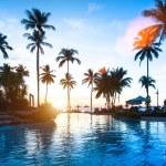 Beautiful sunset at a beach resort in tropics. — Stock Photo