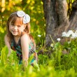 Funny lovely little girl in park — Stock Photo
