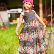 Beautiful little five-year girl posing for the camera in the yard of a village house. — Foto Stock
