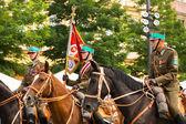 неизвестные участников праздника польской кавалерии в историческом центре города — Стоковое фото