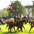 Unidentified participants feast of the Polish cavalry in historical city center — Stock Photo