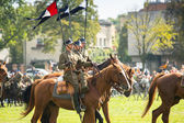 Unidentified participants feast of the Polish cavalry in historical city center — Stockfoto