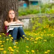 Teengirl in the park with books. — ストック写真
