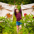 Five-year girl with clothespin — Stockfoto