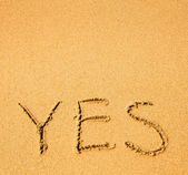 Yes - written in sand — Stock Photo