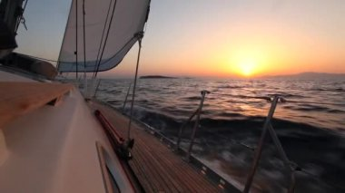 Yacht sailing against sunset. Travel Concept. Sailboat. Luxury yacht. Sailing. Vacation. (HD) — Stock Video