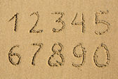 Numbers written on a beach — Stock Photo