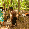 People Orang Asli thresh rice — ストック写真