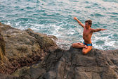 Man doing yoga exercise — Photo