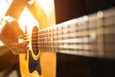Hand playing on acoustic guitar. — Stock Photo