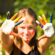Girl with hands in paint — Stock Photo #35454563