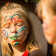 Girl with paint on face — Stock Photo