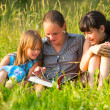Little girls with book — Stok fotoğraf