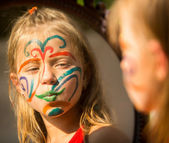 Girl with paint on face — Foto Stock