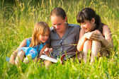Little girls with book — Stock Photo