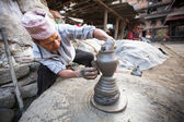 Unidentified Nepalese man working in his pottery workshop — Stock Photo