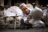 Unidentified Nepalese man working in the his pottery workshop — Stock Photo