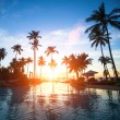 Beautiful sunset at a beach resort in the tropics. — Stock Photo