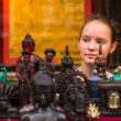 Teengirl in a souvenir shop in Kathmandu. — Stock Photo
