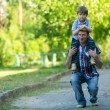 Foto Stock: Father and son outdoors.