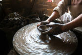 Close-up of hands working clay on potter's wheel. — Stock Photo