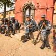 Unknown nepalese soldiers Armed Police Force near public school — Stock Photo