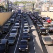 Cars stands in traffic jam on the city center — Stock Photo