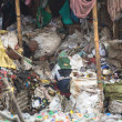 Stock Photo: Unidentified people from poorer areas working in sorting of plastic on dump