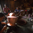 Стоковое фото: Unidentified Nepalese tinmans working in the his workshop