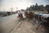 Pile of domestic garbage in carts, bicycles — Stockfoto