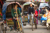 Unidentified nepali rickshaw in historic center of city — Stock Photo