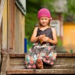 Beautiful little five-year girl on the porch of a village house — Stock Photo