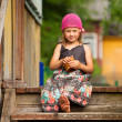 Beautiful little five-year girl on the porch of a village house — Stock Photo #39018031