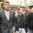 Boris Nemtsov (L) russistatesman, one of leaders of opposition during rally to support 31st article of Constitution — Stock Photo #39018193