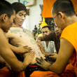Unidentified monk makes traditional Yantrtattooing during Wai Kroo Master Day Ceremony in Wat Bang Pra — Stock Photo #39025485