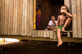Unidentified children Orang Asli in his village in Berdut, Malaysia. — Photo