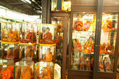 Shop windows with mannequins monks at Chatuchak Weekend Market in Bangkok, Thailand. — Stock Photo