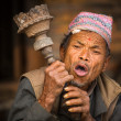 Stock Photo: Nepalese msmokes