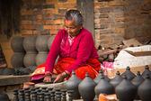 Nepalese man in pottery workshop — Stock Photo