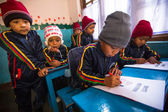 Pupils in English class at primary school — Stockfoto