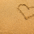 Stock Photo: Inscription heart of sand texture.