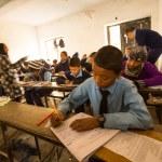 Unknown children in the lesson at public school. — Stock Photo #40565405