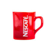 Mug Nescafe coffee — Stock Photo