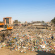 People working in sorting of plastic on dump — Stock Photo #40878729