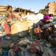 Stock Photo: People working in sorting of plastic on dump