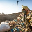 People working in sorting of plastic on dump — Stock Photo #40878827