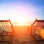 Couple of beach chairs on the evening sea coast. — Stock Photo