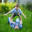 Father and son playing in the grass. — Stok fotoğraf